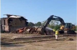 Heavy equipment demolishing building