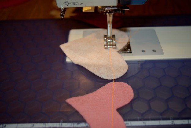 sew across felt hearts