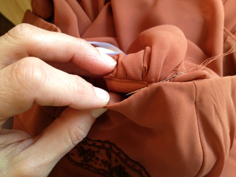 blind stitch by hand into place