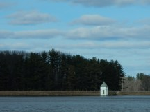 Every reservoir has these buildings. I'm guessing they allow access to pumps or pipes.