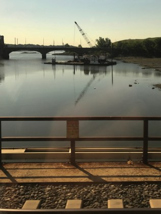 Trains, cranes, bridges and reflections.