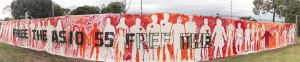Panorama of completed banner: 55 silhouettes for the 55 refugees in ASIO immigration detention limbo. Photo credit Takver
