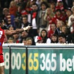 Adam Goodes points the finger after being called an 'ape' by a young Collingwood supporter during the AFL's Indigenous Round. Photo: Andrew White Fairfax