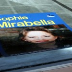 A Mirabella sign hits the dust