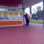 Sophie and Greg Mirabella removing posters wrapped around the Wangaratta Tafe polling booth