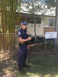 @elisejeanette 22/03/14  Police filming union protesters at community cabinet meeting on the Gold Coast.