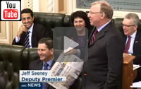 "ABC News Qld: ""The best party ""that Chinese money can buy."" Newman Govt members laugh as Deputy Premier Jeff Seeney accuses Clive Palmer of being a crook."