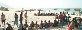 asylum seekers on beach