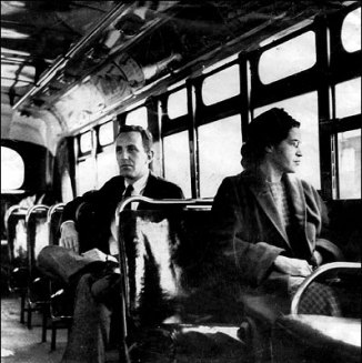 Rosa Parks on a Montgomery bus on December 21, 1956, the day Montgomery's public transportation system was legally integrated.