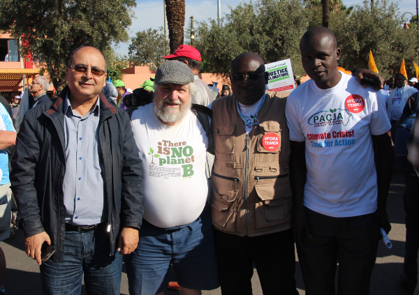 John Englart with a Moroccan and two South African friends at the Climate March
