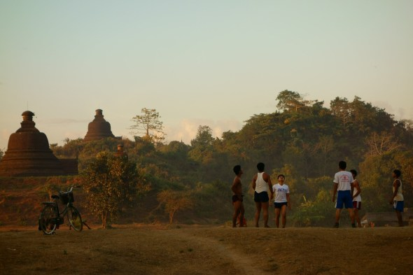 Hacky sack at sunset in front of temples