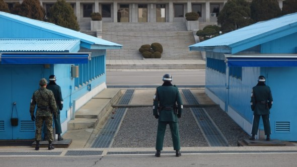 Soldiers look onto North Korea at the DMZ