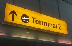 Terminal 2 sign with stylised aircraft