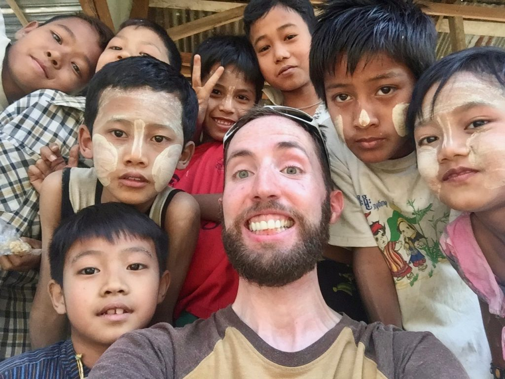 Eight young local kids and I posing for a group selfie
