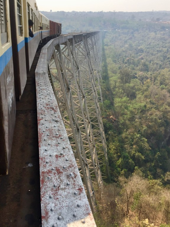 Looking out the window at the Goteik Viaduct rail bridge and train as it curves ahead