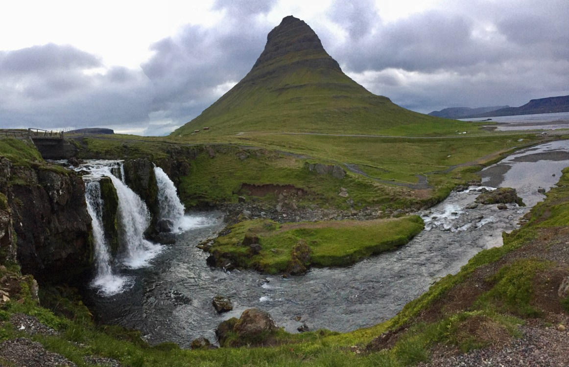 Kirkjufell in the background with Kirkjufelsfoss waterfall in the foreground in early morning light