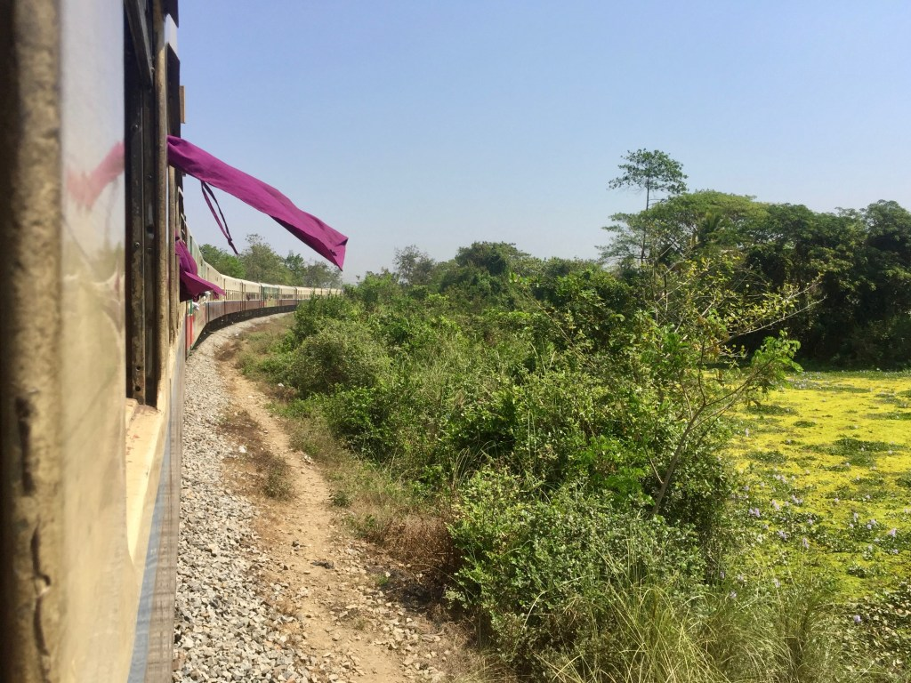 Looking out the window at the curving train on the way to Mawlamyine