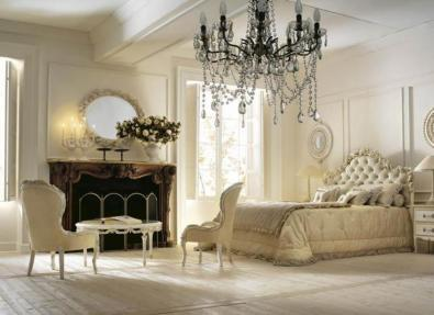 Chandelier-and-fireplace-in-classic-Italian-bedroom