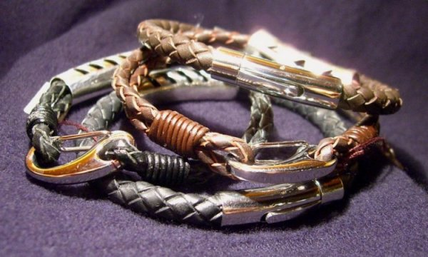 multiple Sonny Ching bracelets