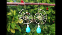 Maki's nautilus earrings