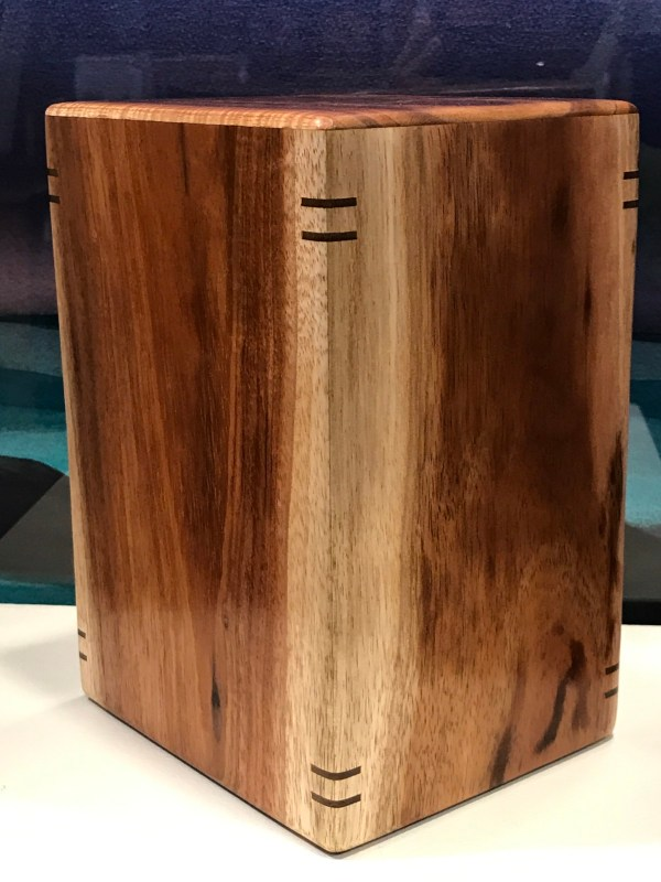 "Large Koa Urn with Splines 9""H x 6.25""W x 5.25""D / interior:8.25""x5.75""x4.75; Capacity 225 lbs"