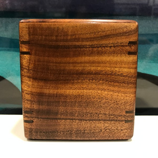 "Small Koa Urn with Splines by Honolulu Woodworks 4""H x 3 7/8""W x 2 7/8""D interior 3.5""x 3.25""x 2.25"" Capacity 25lbs"