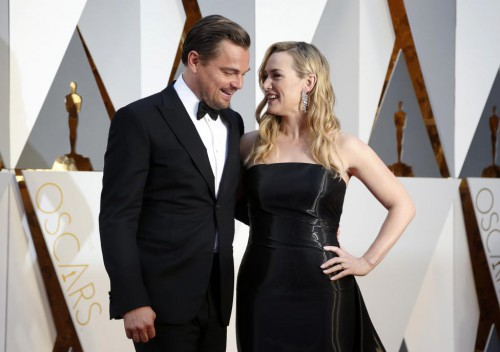 """Kate Winslet, wearing Ralph Lauren and nominated for Best Supporting Actress for her role in """"Steve Jobs,"""" and Leonardo DiCaprio, nominated for Best Actor for his role in """"The Revenant,"""" arrive. REUTERS/Lucy Nicholson"""