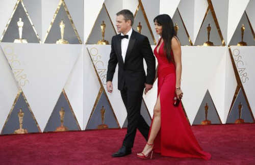 """Matt Damon, nominated for Best Actor for his role in """"The Martian,"""" arrives with his wife Luciana Barroso. REUTERS/Lucy Nicholson"""
