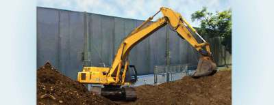 Backhoe-With-Barrier-behind-it