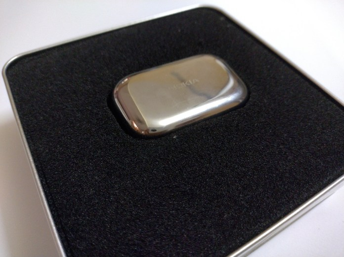 A picture containing indoor, cellphone, case, accessory  Description automatically generated
