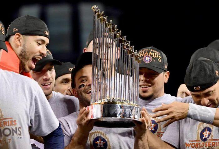 The Astros hoisting their trophy.
