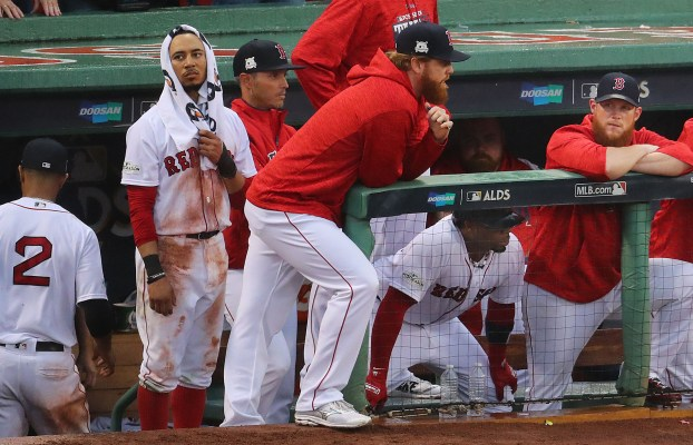 Red Sox are eliminated by the Astros in the 2017 ALDS. Mookie Betts and the other players in the dugout disappointed.