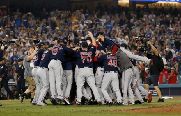 Red Sox celebrate winning the 2018 World Series in a dog pile.