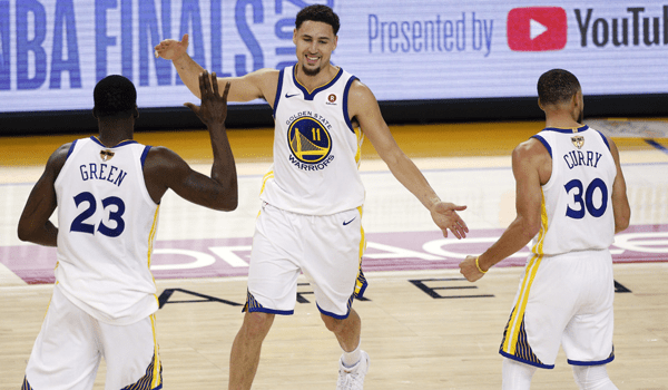 Warriors starters Draymond Green, Klay Thompson and Steph Curry in 2019.