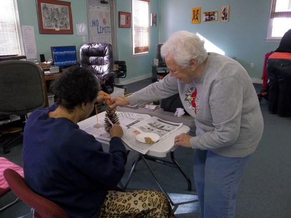 Volunteer Margaret Ann Harris helping Diane make a birdfeeder - the birds love you for feeding them!