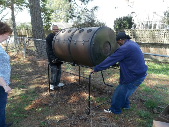 DJ and Steve, the muscle men, moving the compost tumbler to make room for the chicken coop!
