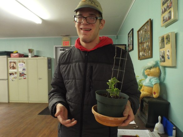 Brandon posing with his new ivy plant given to him by the nice lady who works at Bayside Rehab. in Parksley.