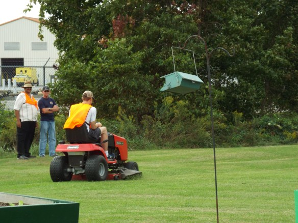 Brandon is doing a great job learning to mow the lawn.
