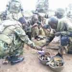 Heeeyaah!! Checkout This Touching This Photo Of Gallant Nigerian Soldiers Eating on the Ground