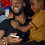 Watch the emotional moment singer Flavour met blind little boy who is one of his biggest fans in Liberia (photos/video)
