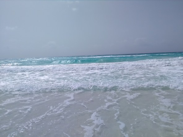 Picture is of a beautiful beach with waves coming in just like the waves of God's judgement