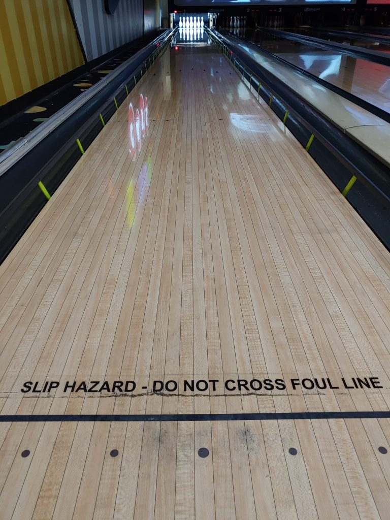Bowling lane with the bumpers up and a clearly marked foul line to see the analogy between bumper bowling and our Christian walk.