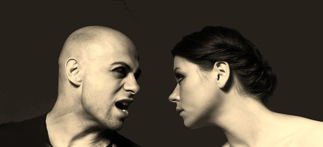 This is a picture of an angry man facing a woman to illustrate the concept that iniquity abounds in these last days.