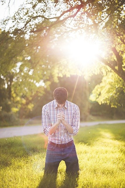 This is a picture of a man bowing down to worship God.