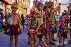 Children in costume for the Pase del Niño parade in Cuenca, Ec
