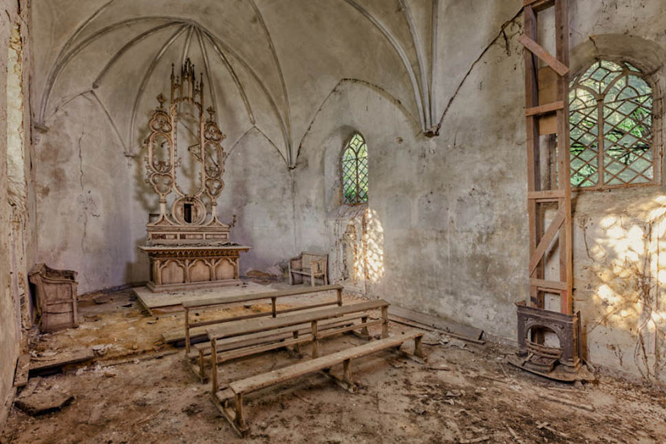 abandoned church with benches and altar