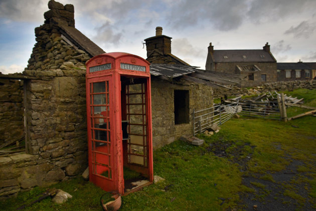 FOULA, SCOTLAND - SEPTEMBER 30: Building and telephone box on the Island of Foula on September 29, 2016 in Foula, Scotland. Foula is the remotest inhabited island in Great Britain with a current population of thirty people,and has been owned since the turn of the 20th century by the Holbourn family. (Photo by Jeff J Mitchell/Getty Images)