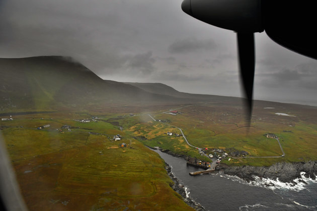 FOULA, SCOTLAND - SEPTEMBER 28: The plane arrives from Tingwall airport at the Island of Foula airstrip on September 28, 2016 in Foula, Scotland. Foula is the remotest inhabited island in Great Britain with a current population of thirty people and has been owned since the turn of the 20th century by the Holbourn family. (Photo by Jeff J Mitchell/Getty Images)