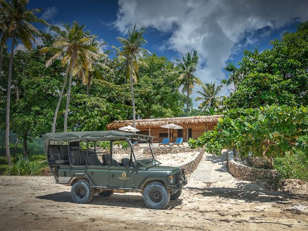 guests-can-also-travel-by-safari-jeep-or-boat-to-neighboring-bays-with-less-advanced-surfing-spots