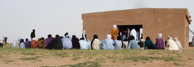 Located on the annual migration route for nomads, in Niger, the Tamesna clinic, staffed by a full time nurse provides basic medical care for. nomads Tamesna clinic at right with water storage tank supplied by solar powered pump.